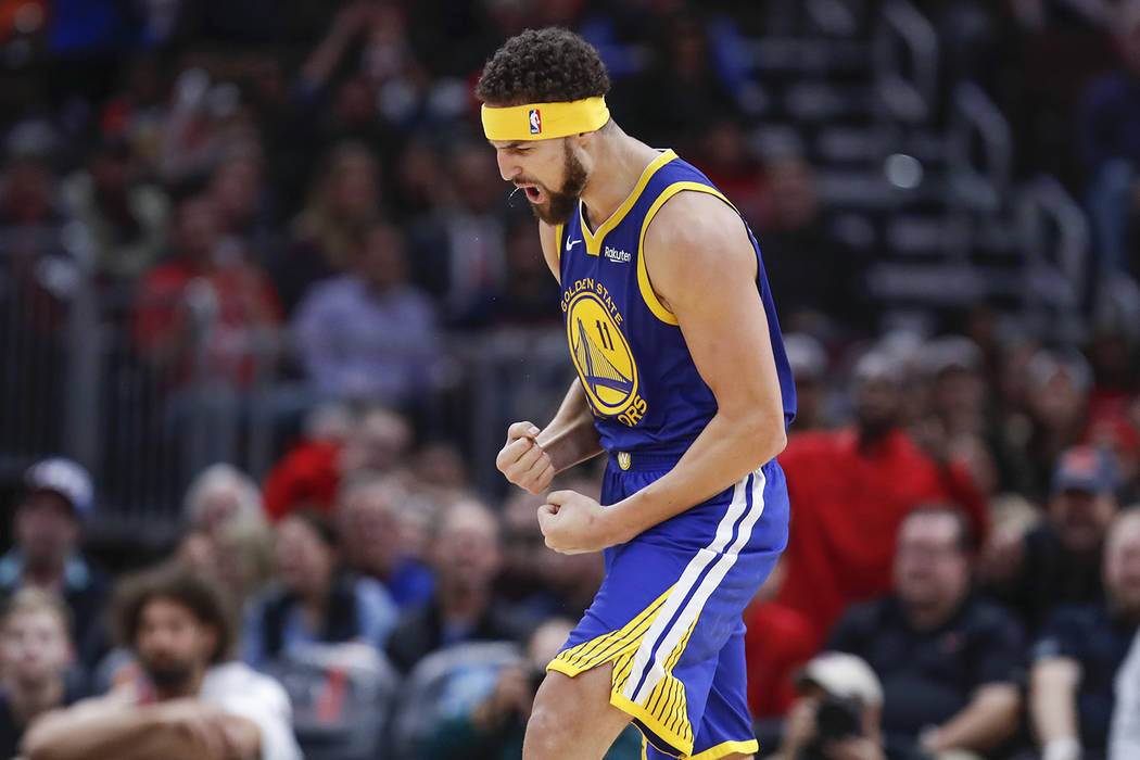 dbae84f55eef Golden State Warriors guard Klay Thompson celebrates after scoring a three  pointer against the Chicago Bulls