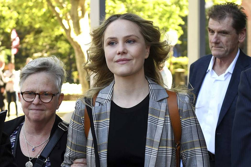 Actress Eryn Jean Norvill, center, leaves the Federal Court in Sydney, Australia, Tuesday, Oct. 30, 2018, after giving evidence during a defamation trial brought on by fellow actor Geoffrey Rush. ...