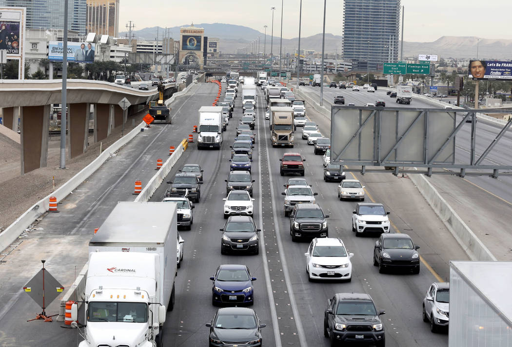 "Traffic backs up in the northbound lanes of Interstate 15 in Las Vegas on Wednesday, March 7, 2018 as the ""Main Event,"" the $1 billion reconfiguration of the Spaghetti Bowl interchan ..."