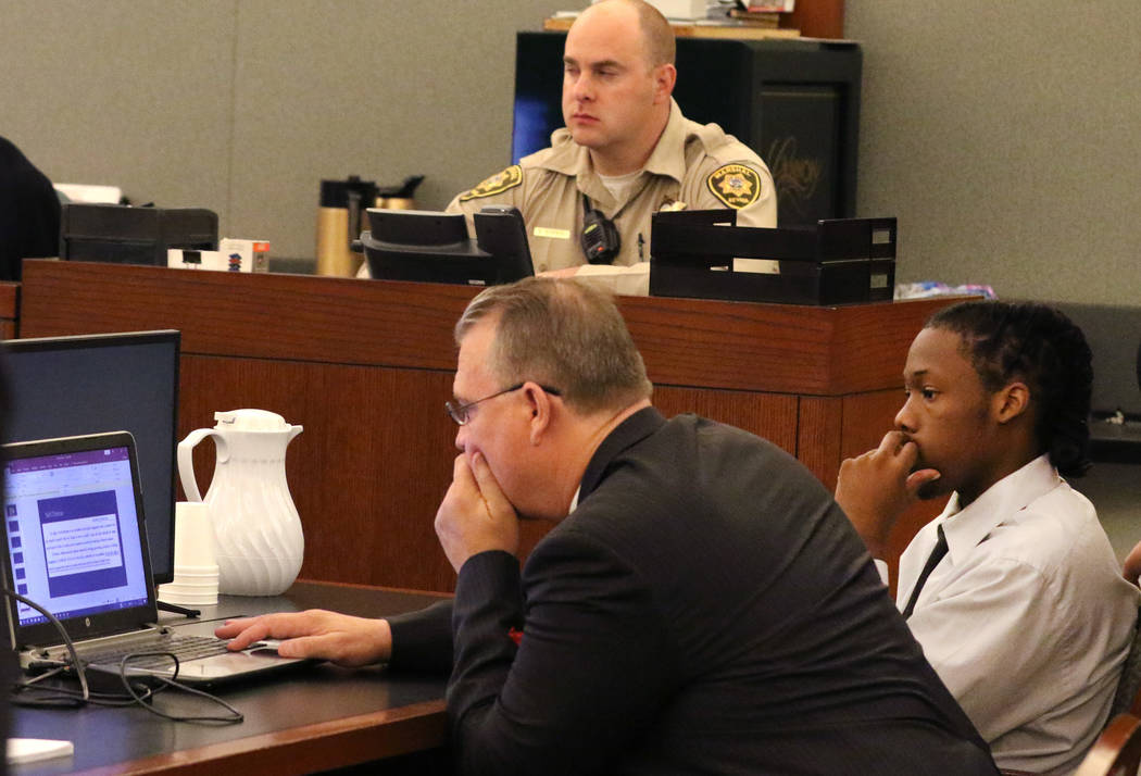 Norman Smith, second right, accused of shooting and killing Tinesha Antovia Adams, who was pregnant, and his attorney Bret Whipple, left, review court documents during his murder trial at the Regi ...