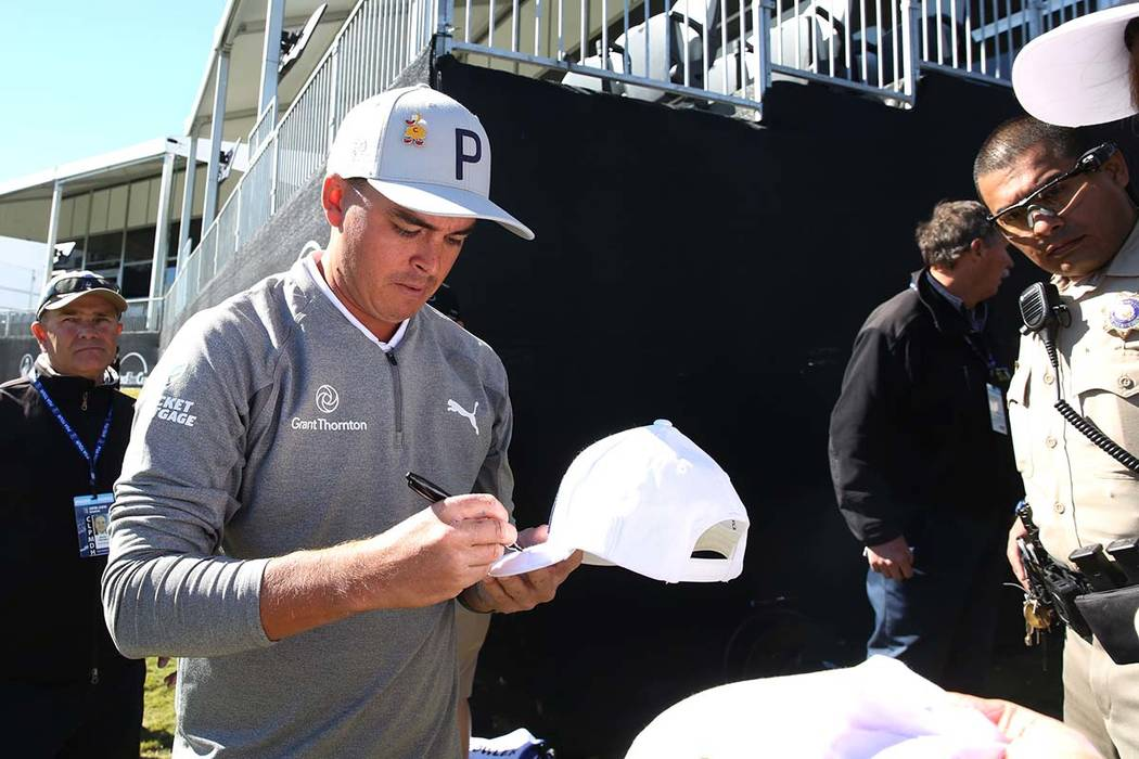 Rickie Fowler signs signs autographs after the first day of the Shriners Hospitals for Children Open golf tournament at TPC Summerlin on Wednesday, Oct. 31, 2018, in Las Vegas. Bizuayehu Tesfaye/L ...