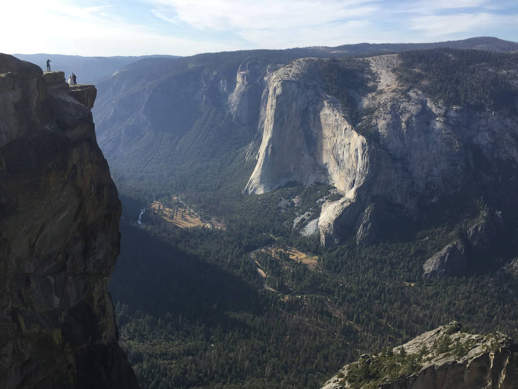 In this Thursday, Sept. 27, 2018 file photo, an unidentified couple gets married at Taft Point in California's Yosemite National Park. The viewpoint overlooks Yosemite Valley, including El Capitan ...