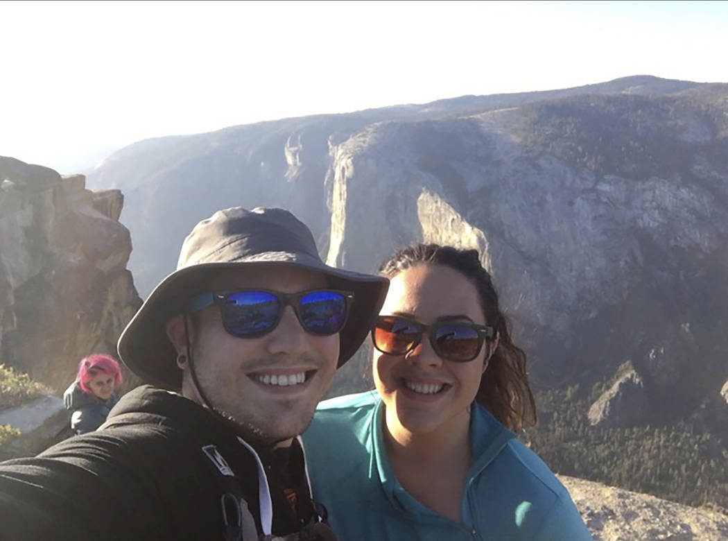 In this Oct. 21, 2018 photo provided by Sean Matteson, Matteson poses for a selfie with his girlfriend Drea Rose Laguillo, in Yosemite National Park, Calif. The couple said Meenakshi Moorthy, seen ...