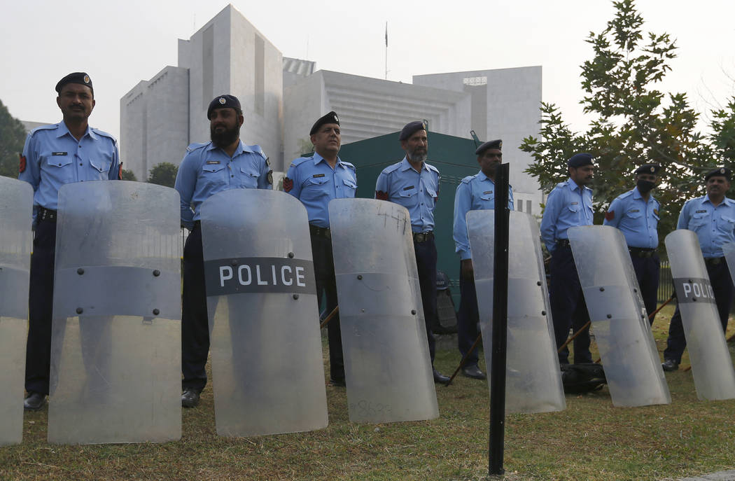 Pakistani police officers stand guard outside the supreme court in Islamabad, Pakistan, Wednesday, Oct. 31, 2018. Pakistan's top court acquitted a Christian woman who has been on death row since 2 ...