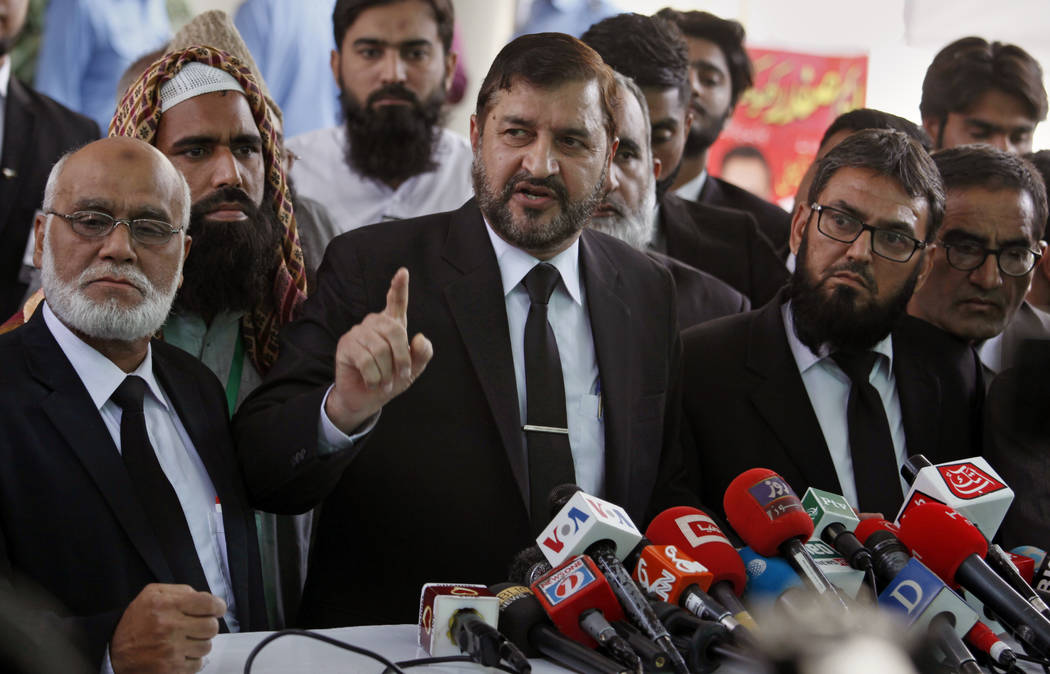 Pakistani lawyers who are contesting the case against Asia Bibi, a Pakistani Christian woman convicted of blasphemy, speaks to media outside the Supreme court, in Islamabad, Pakistan, Wednesday, O ...