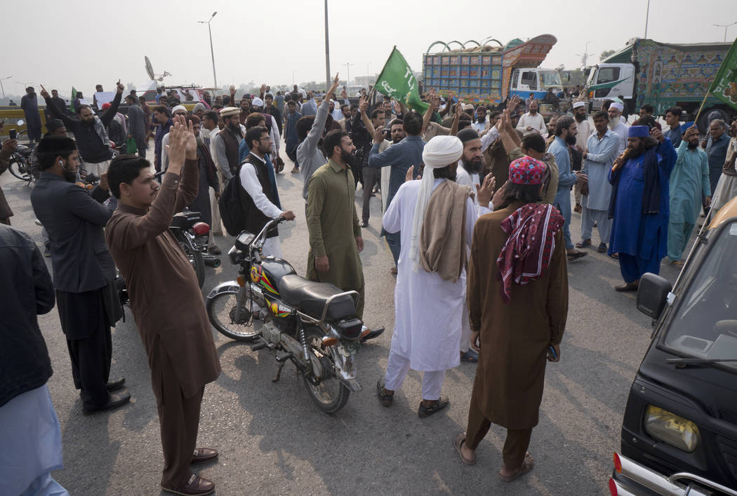 Supporters of a Pakistani religious group protest after blocking a main road after a court decision, in Islamabad, Pakistan, Wednesday, Oct. 31, 2018. Pakistan's top court on Wednesday acquitted C ...