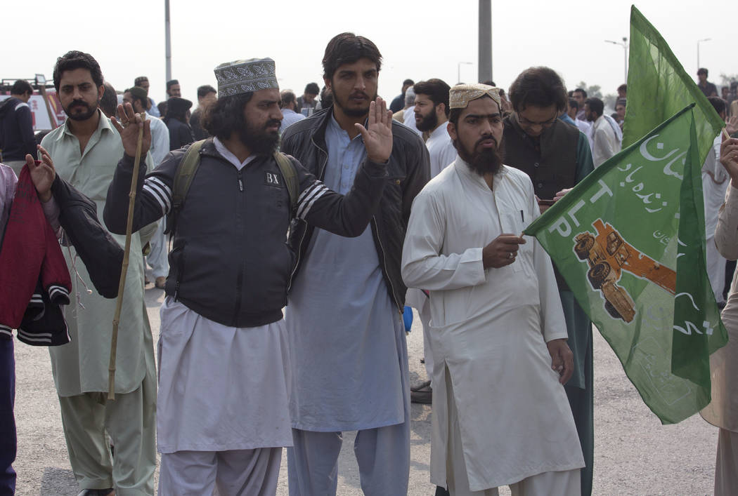 Supporters of a Pakistani religious group block main road after a court decision, to Islamabad in Pakistan, Wednesday, Oct. 31, 2018. Pakistan's top court on Wednesday acquitted Christian woman A ...
