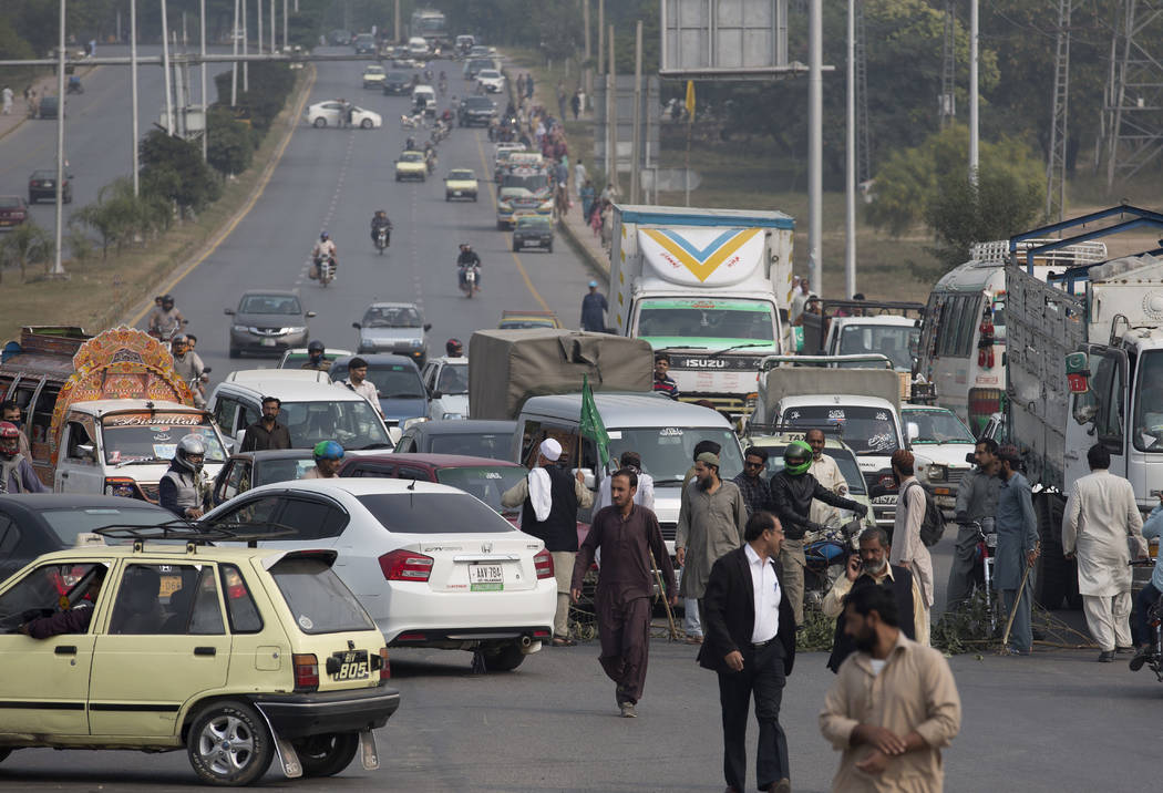 Supporters of a Pakistani religious group block a main road after a court decision in Islamabad, Pakistan, Wednesday, Oct. 31, 2018. Pakistan's top court on Wednesday acquitted Christian woman Asi ...