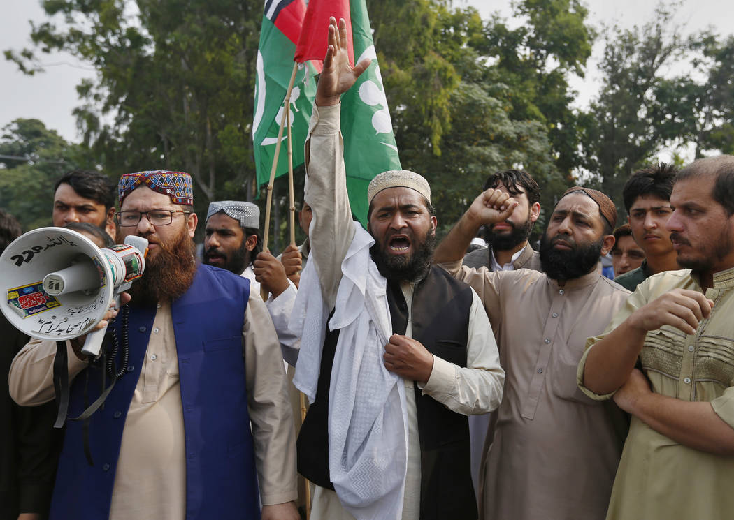 Supporters of a Pakistani religious group chant slogans during a protest after a court decision, in Islamabad in Pakistan, Wednesday, Oct. 31, 2018. Pakistan's top court on Wednesday acquitted a C ...