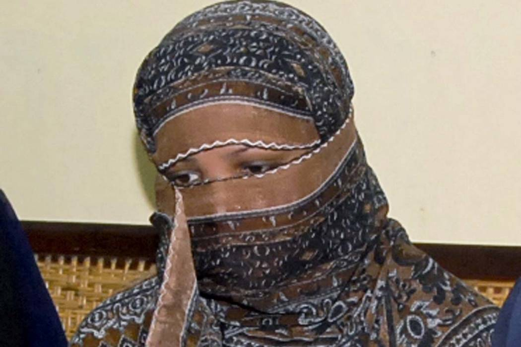 In this Nov. 20, 2010, file photo, Asia Bibi, a Pakistani Christian woman, listens to officials at a prison in Sheikhupura near Lahore, Pakistan. Pakistan's top court on Wednesday, Oct. 31, 2018, ...