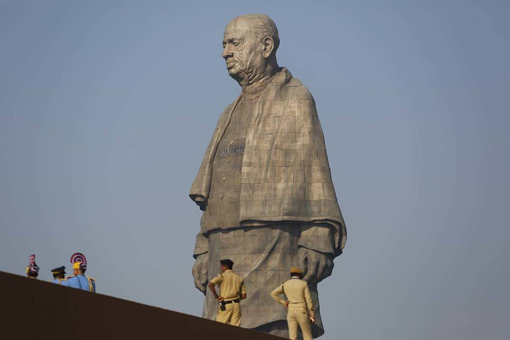 Indian policemen gather next to the Statue of Unity at Kevadiya colony in Gujarat state, India, Wednesday, Oct. 31, 2018. The 182-meters (597 feet) bronze statue of Sardar Vallabbhai Patel, a key ...