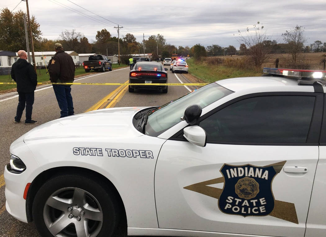 In this photo provided by WSBT 22, authorities work at the scene Tuesday, Oct. 30, 2018, near Rochester, Ind., where several children were struck and killed by a pickup truck as they were about to ...