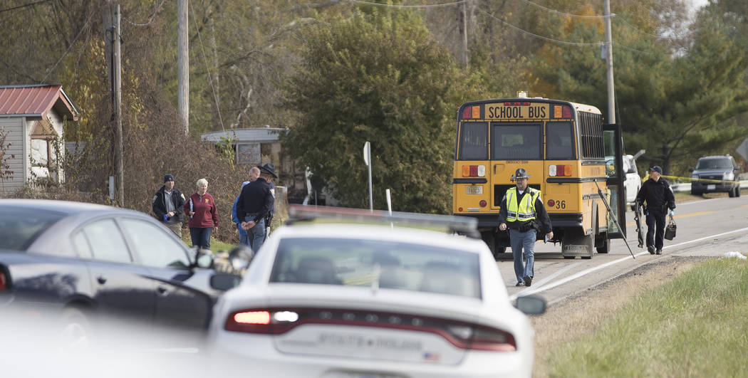 Emergency personnel responded to a scene of a collision that killed three children crossing SR 25 as they were boarding their school bus north of Rochester, Ind., on Tuesday, Oct. 30, 2018. (Santi ...