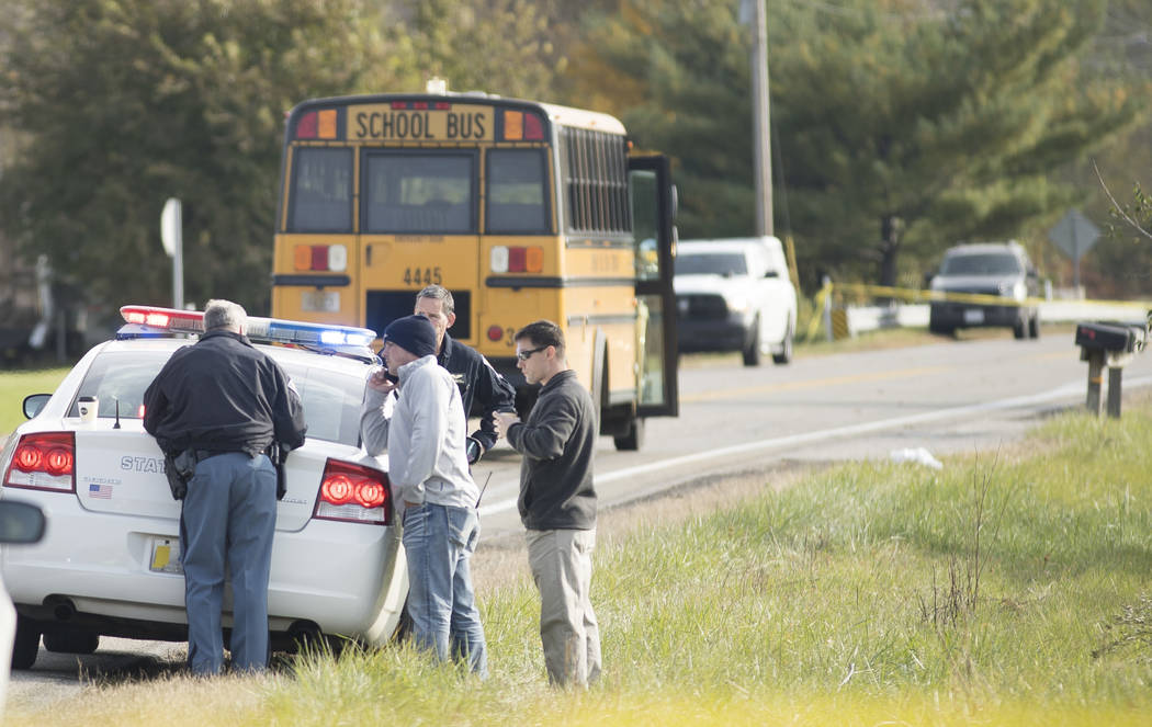 Emergency personnel responded to a scene of a collision that killed three children crossing SR 25 as they were boarding their school bus north of Rochester, Indiana on Tuesday, Oct. 30, 2018,. (Sa ...