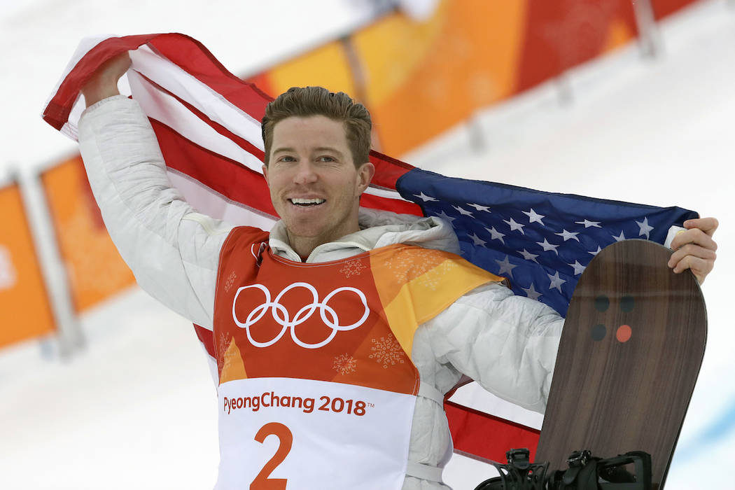 Gold medal winner Shaun White, of the United States, celebrates after the men's halfpipe finals at Phoenix Snow Park at the 2018 Winter Olympics in Pyeongchang, South Korea, Wednesday, Feb. 14, 20 ...
