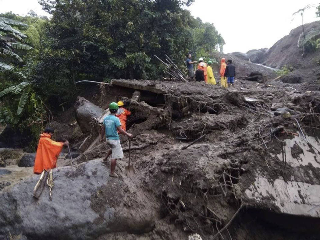Mountain Province District Engineering Office, rescuers dig through the earth to search for survivors after a massive landslide in Natonin township, Mountain Province in northern Philippines Wedne ...