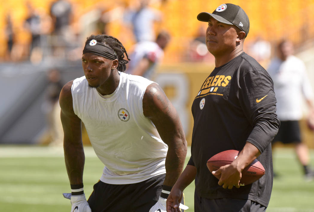 Pittsburgh Steelers wide receiver Martavis Bryant, left, talks with former Steelers wide receiver Hines Ward as he warms up before of an NFL preseason football game against the Atlanta Falcons, Su ...
