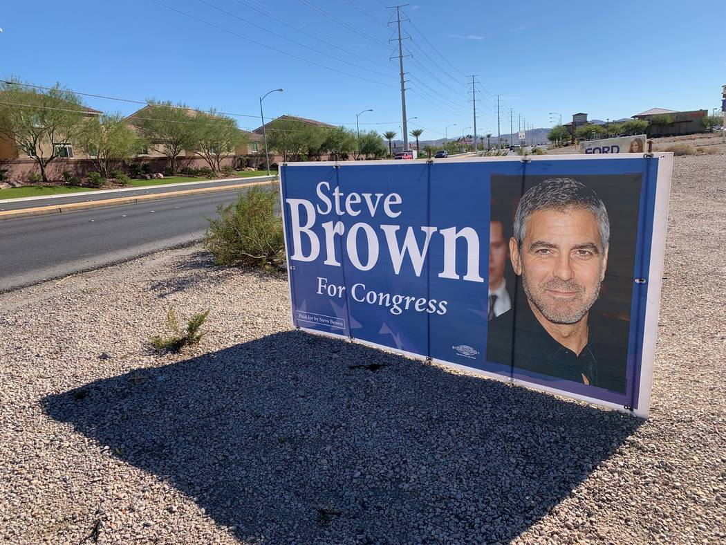 Libertarian Congressional candidate Steve Brown put up signs with George Clooney's face as a lighthearted joke (Mat Luschek/Review-Journal)