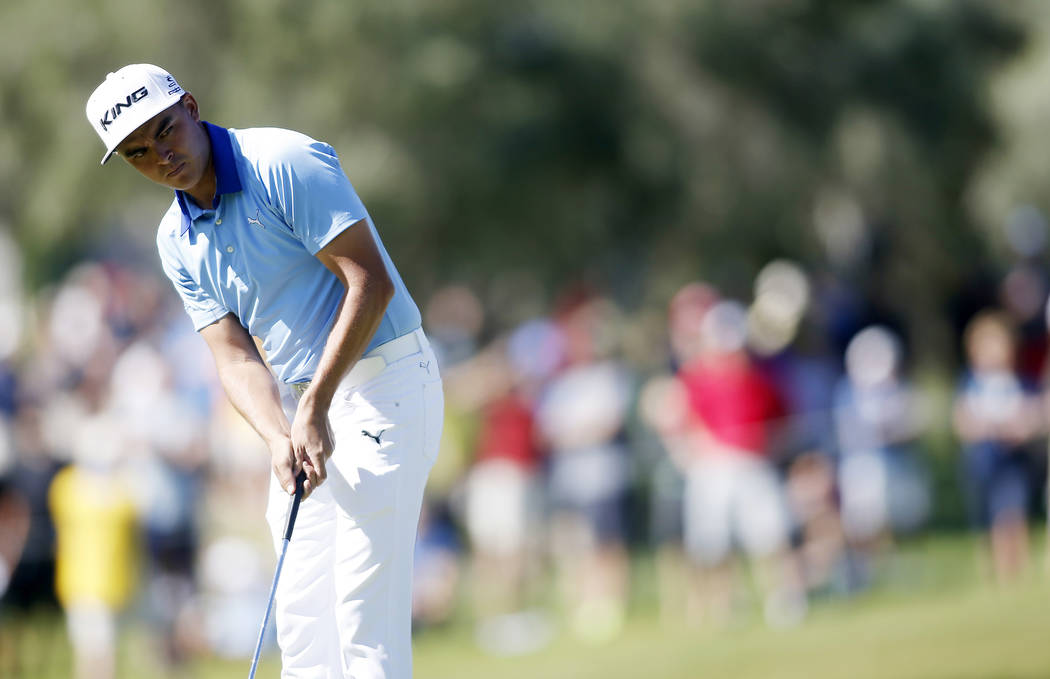 Rickie Fowler putts on the eighth green during the third round of the Shriners Hospitals for Children Open golf tournament Saturday, Oct. 24, 2015, in Las Vegas. Fowler helped to spike an attendan ...