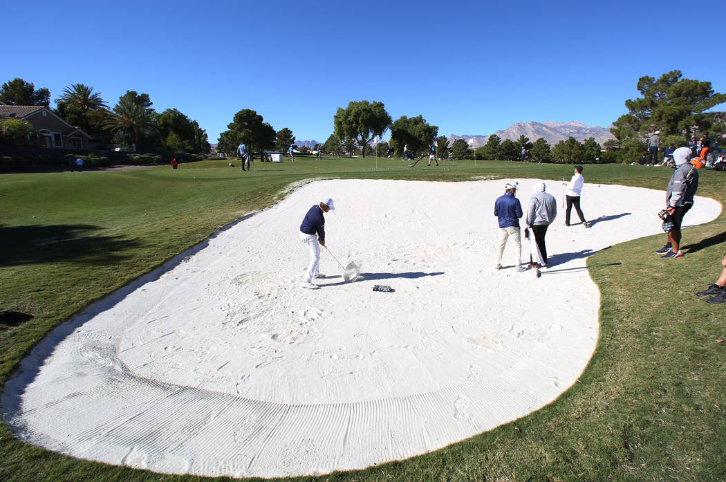 Curtis Luck, left, of Australia hits from sand trap as he prepares for the Shriners Hospitals for Children Open golf tournament at TPC Summerlin on Wednesday, Oct. 31, 2018, in Las Vegas. Bizuayeh ...