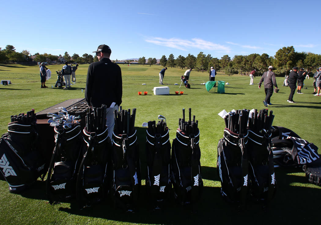 Golfers practice at a driving range as they prepare for the Shriners Hospitals for Children Open golf tournament at TPC Summerlin on Wednesday, Oct. 31, 2018, in Las Vegas. Bizuayehu Tesfaye/Las V ...