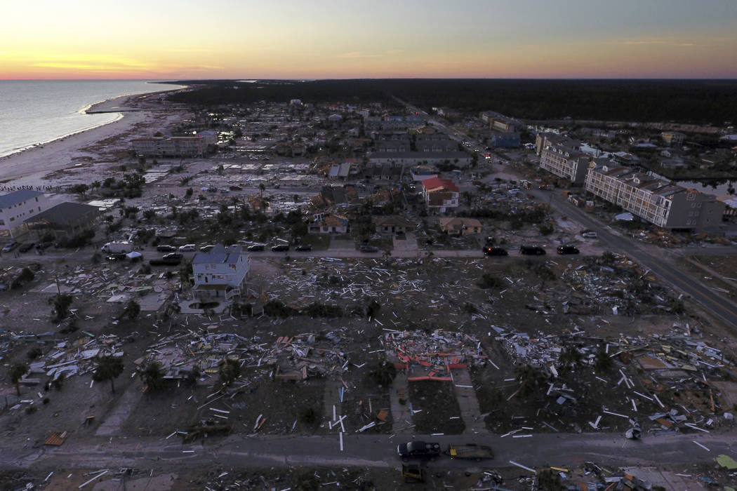 Damaged homes are seen along the water's edge in the aftermath of hurricane Michael in Mexico Beach, Fla. on Oct. 12, 2018. (AP Photo/David Goldman, File)