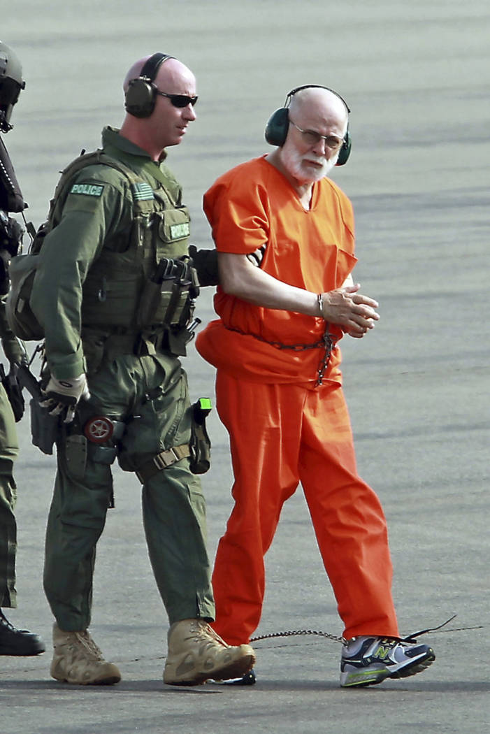 "FILE - In this June 30, 2011 file photo, James ""Whitey"" Bulger, right, is escorted from a U.S. Coast Guard helicopter to a waiting vehicle at an airport in Plymouth, Mass., after attendi ..."