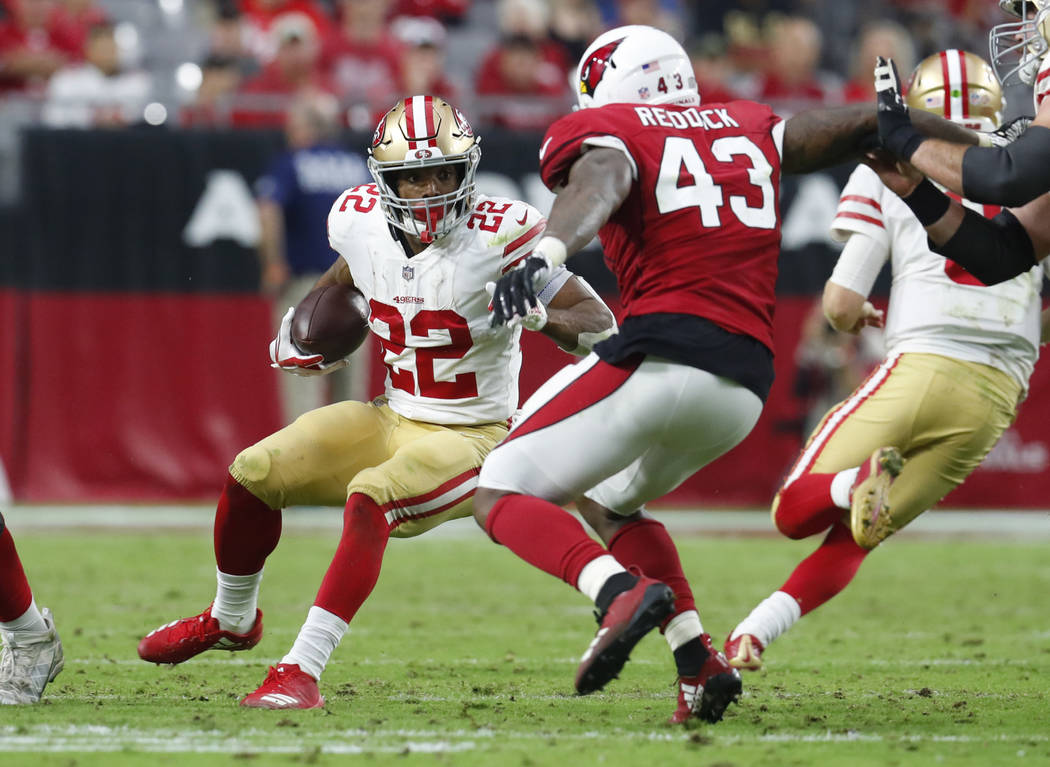 San Francisco 49ers running back Matt Breida (22) runs as Arizona Cardinals linebacker Haason Reddick (43) pursues during the second half of an NFL football game, Sunday, Oct. 28, 2018, in Glendal ...