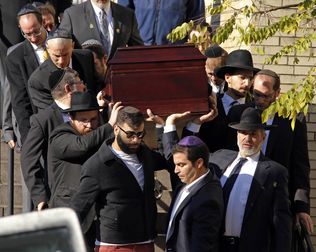 Pallbearers carry the casket of Joyce Fienberg from the Beth Shalom Synagogue following a funeral service in the Squirrel Hill neighborhood of Pittsburgh, Wednesday, Oct. 31, 2018. Fienberg, 75, ...
