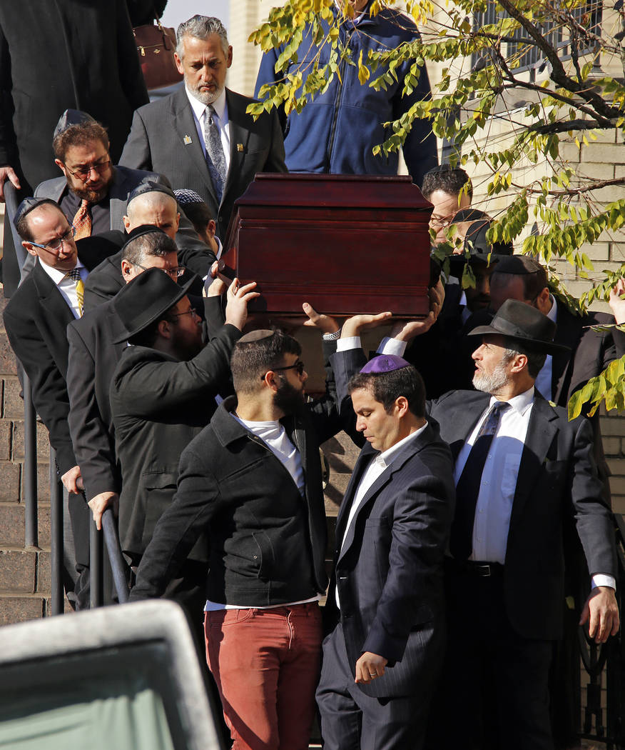 Pallbearers carry the casket of Joyce Fienberg from the Beth Shalom Synagogue following a funeral service in the Squirrel Hill neighborhood of Pittsburgh, Wednesday, Oct. 31, 2018. Fienberg, 75, M ...