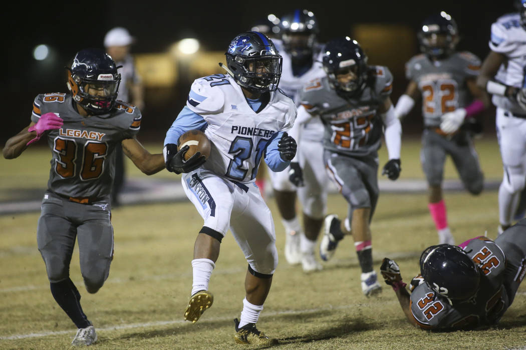 Canyon Springs' Martin Blake (21) runs the ball during the first half of a football game at Legacy High School in North Las Vegas on Thursday, Oct. 25, 2018. Chase Stevens Las Vegas Review-Journal ...