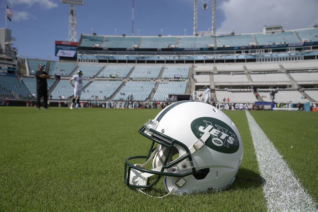 A New York Jets helmet sits on the field during warmups before an NFL football game against the Jacksonville Jaguars Sunday, Sept. 30, 2018, in Jacksonville, Fla. (AP Photo/Phelan M. Ebenhack)