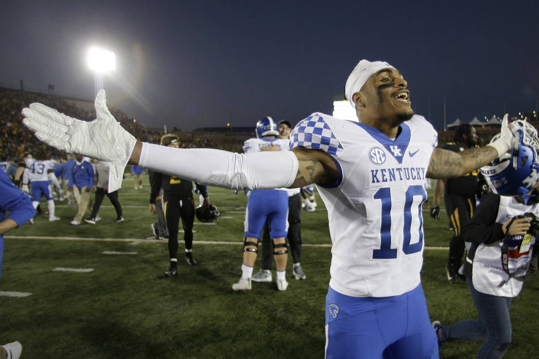 Kentucky running back Asim Rose (10) celebrates as he walks off the field after Kentucky won an NCAA college football game against Missouri on a touchdown with no time left on the clock Saturday, ...