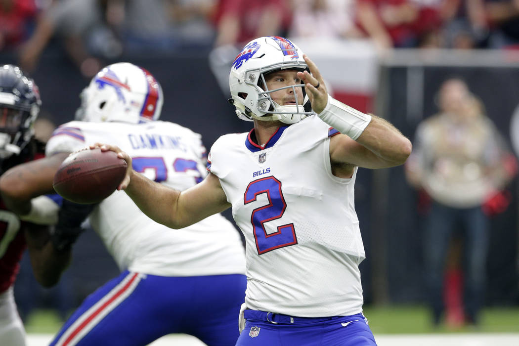 In this Oct. 14, 2018, file photo, Buffalo Bills quarterback Nathan Peterman (2) passes during the second half of an NFL football game against the Houston Texans, in Houston. (AP Photo/Michael Wyk ...