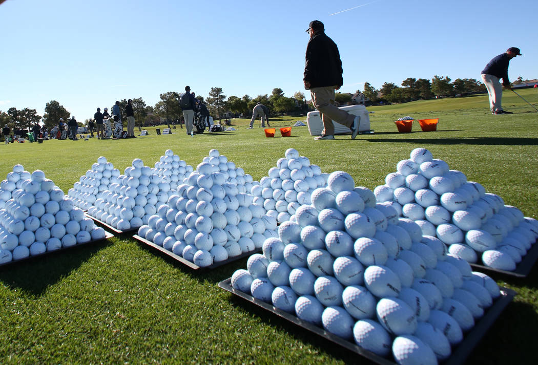 Golf balls are displayed as golfers practice at a driving range as they prepare for the Shriners Hospitals for Children Open golf tournament at TPC Summerlin on Wednesday, Oct. 31, 2018, in Las Ve ...