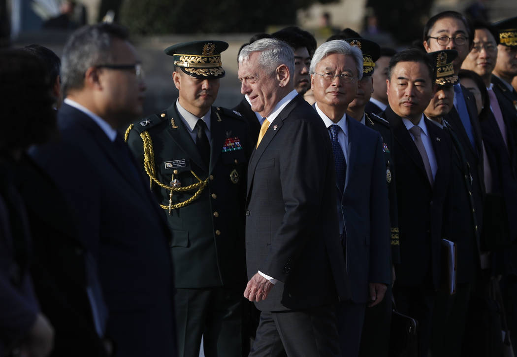 Defense Secretary Jim Mattis, center, walks past members of the South Korean delegation as he co-hosts the 2018 Security Consultative, with South Korea Minister of Defense Jeong Kyeong-doo, at the ...