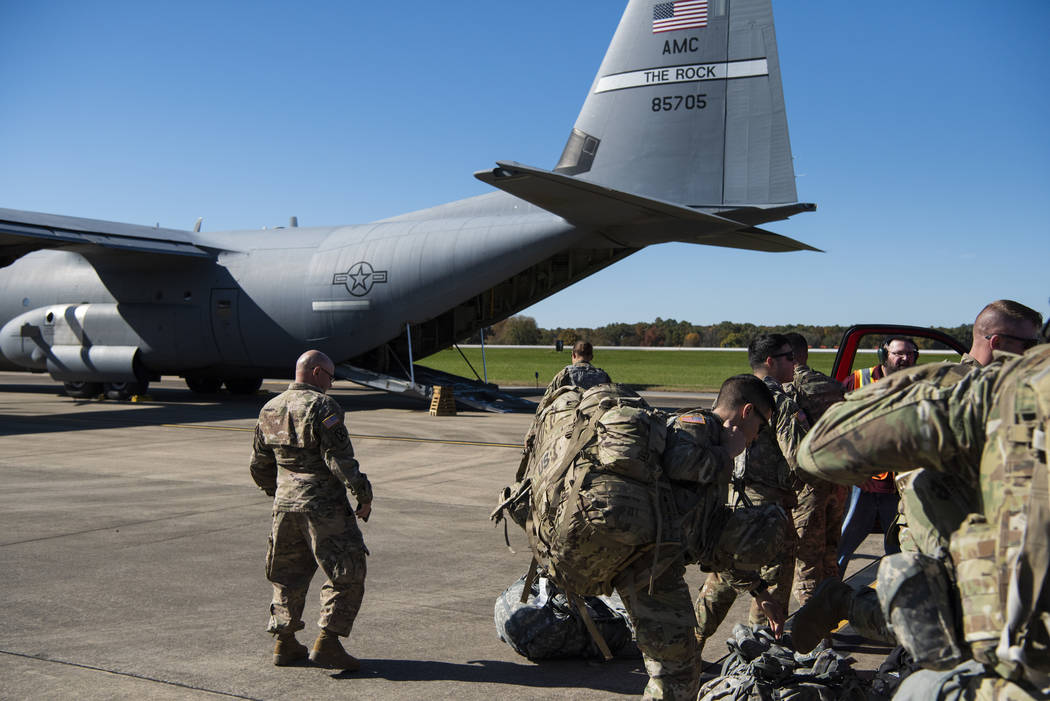 Deployers from Headquarters Company, 89th Military Police Brigade, Task Force Griffin get ready to board a C-130J Super Hercules from Little Rock, Arkansas, at Fort Knox, Kentucky, in support of O ...