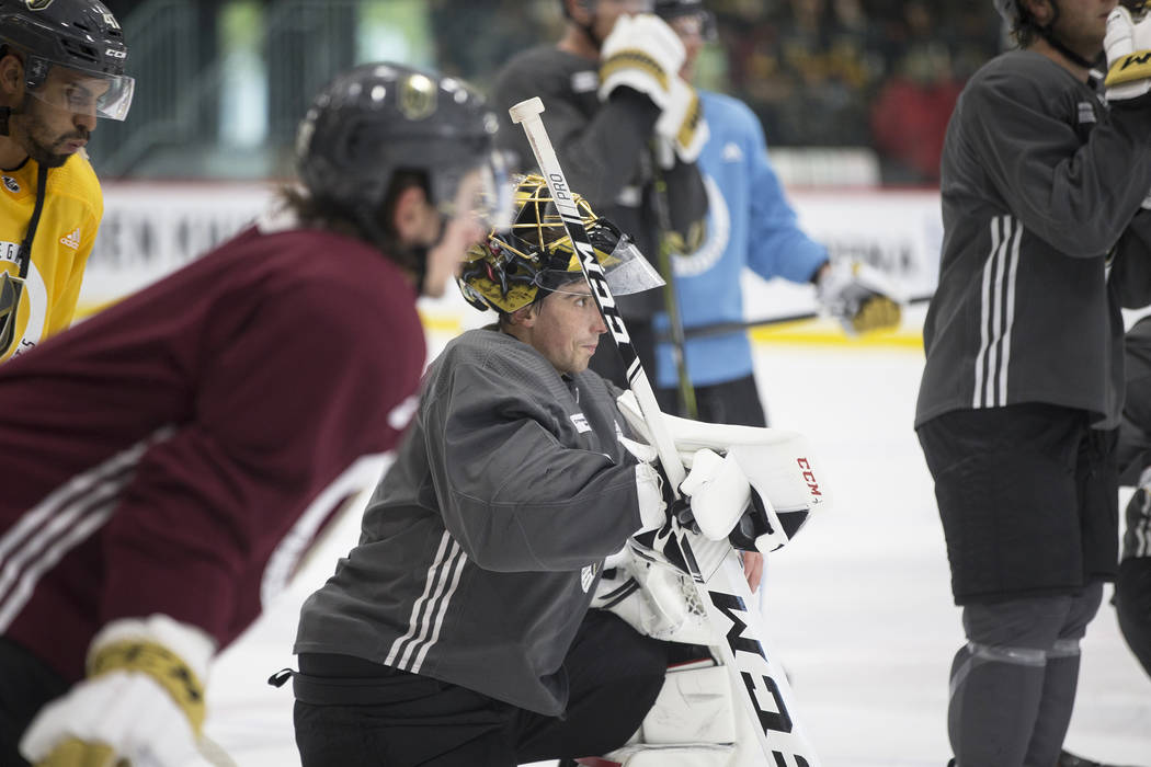 Golden Knights goaltender Marc-Andre Fleury, middle, watches teammates during practice on Wednesday, Oct. 3, 2018, at City National Arena, in Las Vegas. Benjamin Hager Las Vegas Review-Journal @be ...