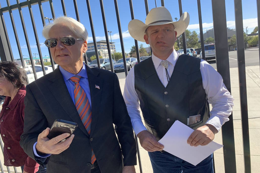 Ryan Bundy, right, and his attorney after a press conference outside of U.S. District Court in Las Vegas on Wednesday, Oct. 31, 2018. (Mat Luschek/Las Vegas Review-Journal)