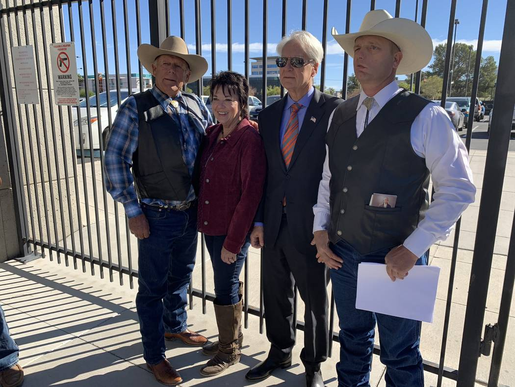 Ryan Bundy, right, stands with his parents and his attorney after a press conference outside of U.S. District Court in Las Vegas on Wednesday, Oct. 31, 2018. (Mat Luschek/Las Vegas Review-Journal)