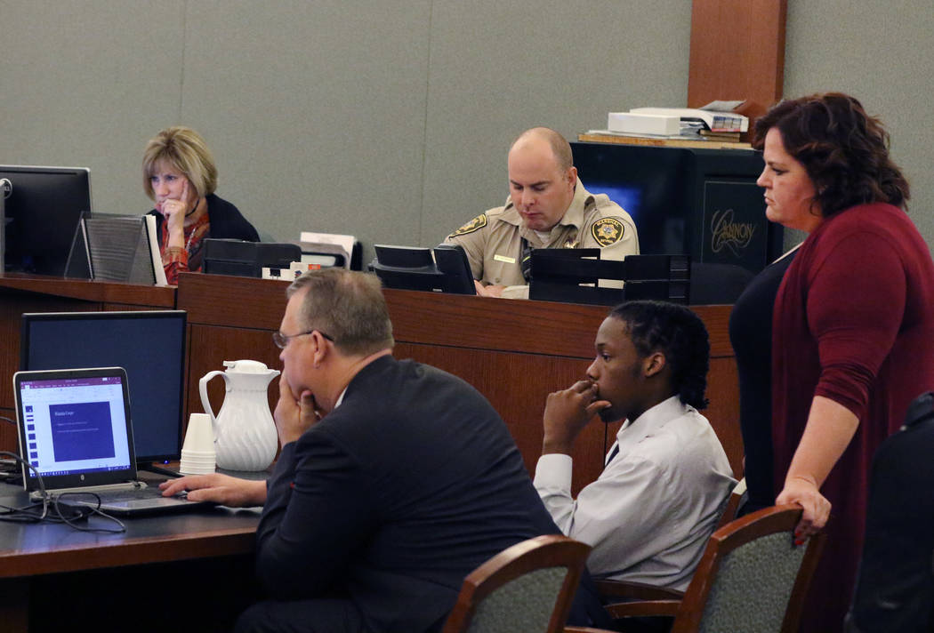Norman Smith, second right, accused of shooting and killing Tinesha Antovia Adams, who was pregnant, and his attorney Bret Whipple, left, review court documents Tuesday during his murder trial at ...