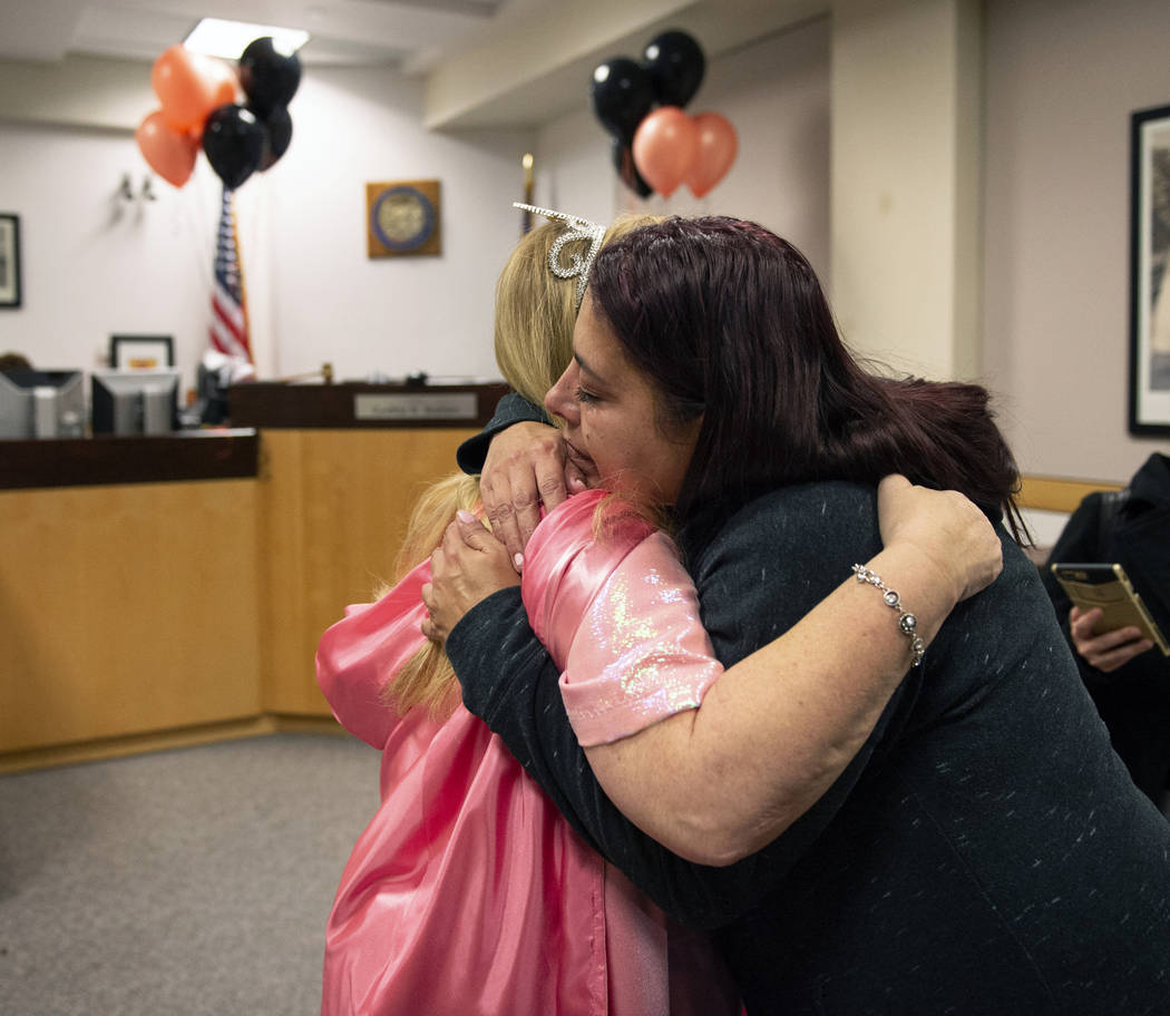 Dawn Hentzi hugs District Court Family Judge Cynthia Giuliani after finalizing the adoption process at Family Court in Las Vegas, Wednesday, Oct. 31, 2018. Caroline Brehman/Las Vegas Review-Journal