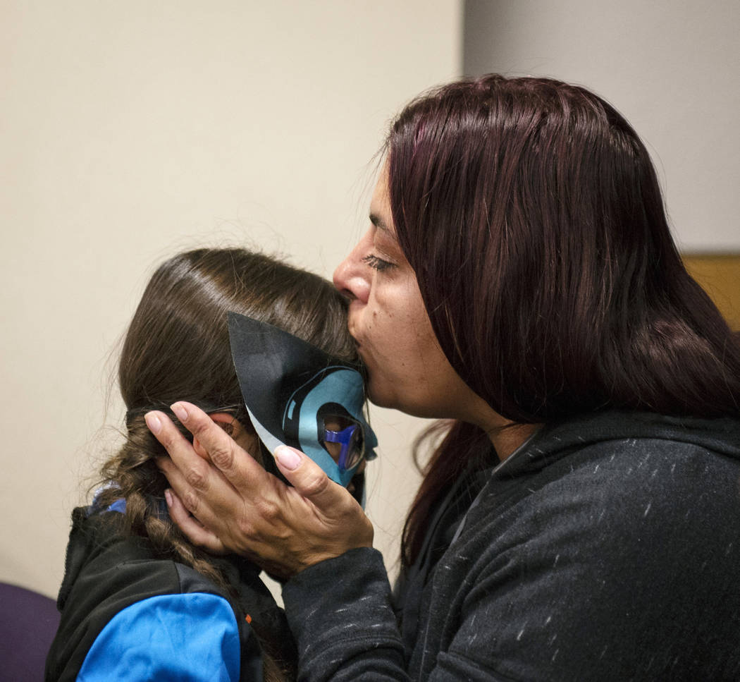 Dawn Hentzi kisses her newly adopted family member Ammerah, 6, after they are sworn in by District Court Family Judge Cynthia Giuliani at Family Court in Las Vegas, Wednesday, Oct. 31, 2018. Carol ...