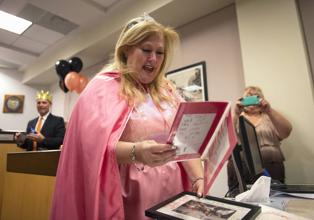 District Court Family Judge Cynthia Giuliani opens a gift from the Lawter family after finalizing the adoption process with her new family at Family Court in Las Vegas, Wednesday, Oct. 31, 2018. C ...