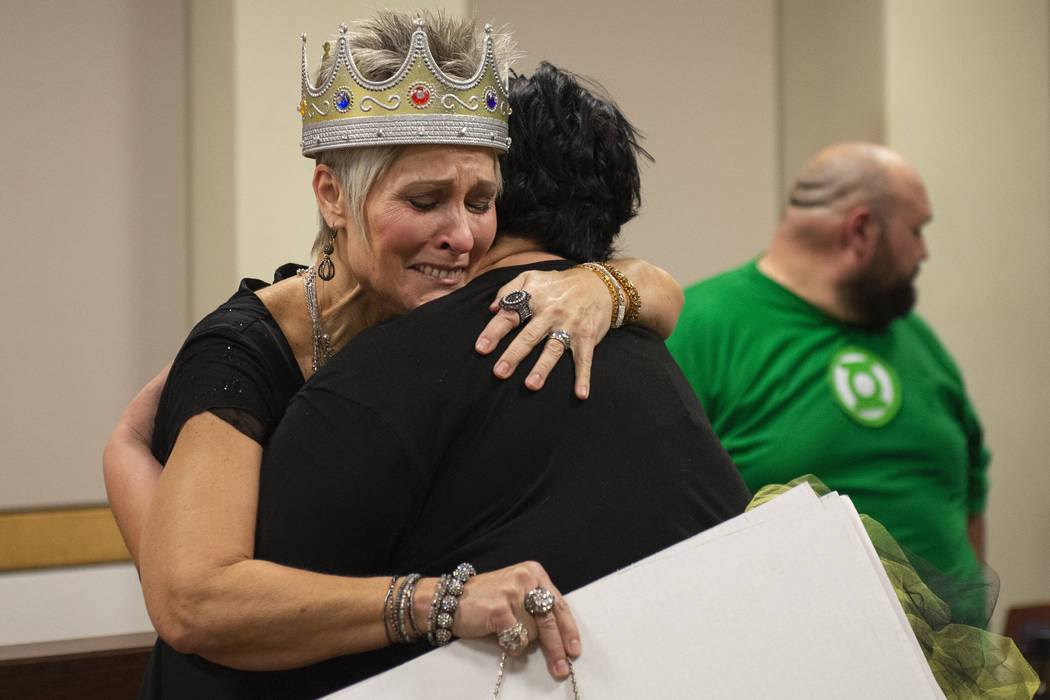 Debbie Haining hugs her daughter after gaining three new grandchildren after the Lawter family finalizes the adoption process after being sworn in by District Court Family Judge Cynthia Giuliani a ...
