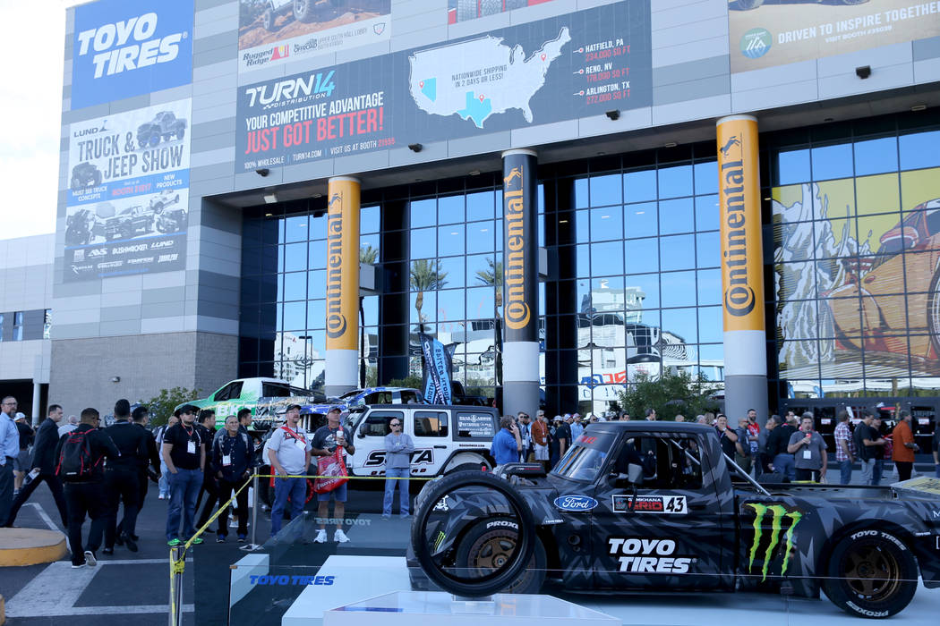 Conventioneers check out the Toyo Tires booth at the Specialty Equipment Market Show at the Las Vegas Convention Center Wednesday, Oct. 31, 2018. The SEMA Show 2018 runs through Nov. 2. K.M. Canno ...