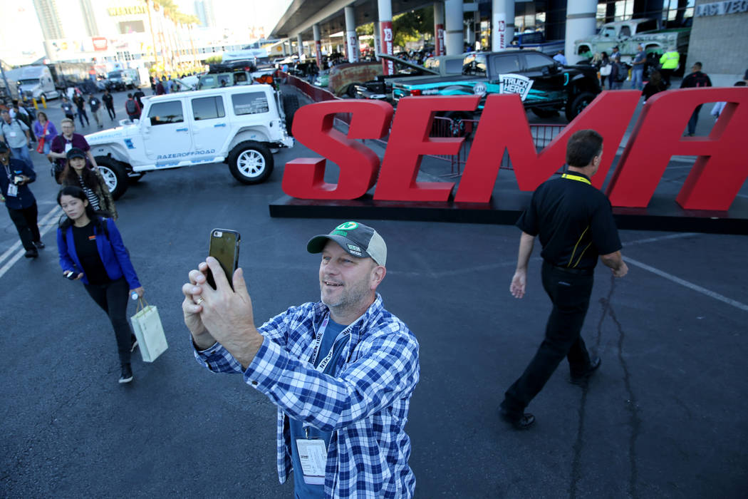 David Fortuna of North Branch, Minn. takes a selfie at the Specialty Equipment Market Show at the Las Vegas Convention Center Wednesday, Oct. 31, 2018. The SEMA Show 2018 runs through Nov. 2. K.M. ...