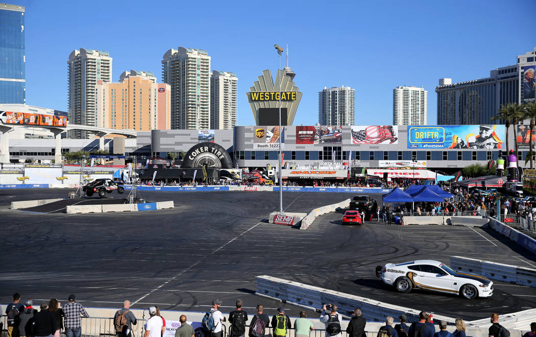 Cars perform at the Ford Out Front performance demonstration track at the Specialty Equipment Market Show at the Las Vegas Convention Center Wednesday, Oct. 31, 2018. The SEMA Show 2018 runs throu ...