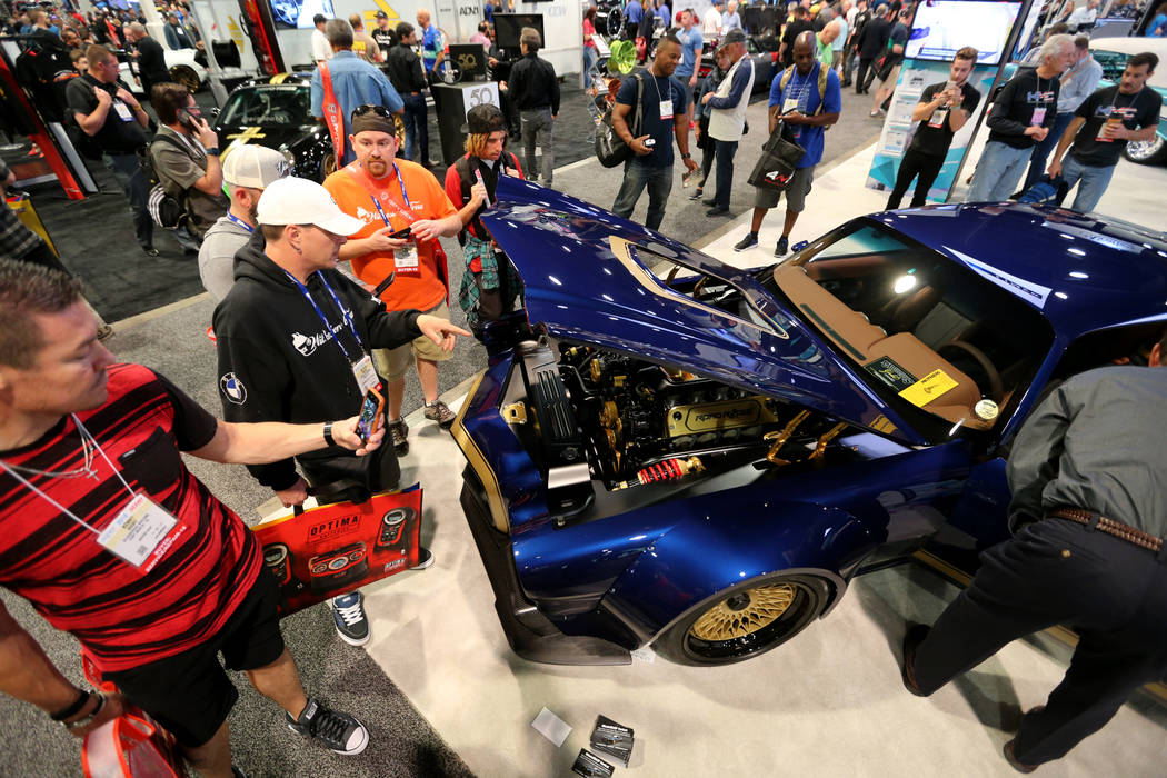 Conventioneers check out BASF Automotive Refinish Coatings booth at the Specialty Equipment Market Show at the Las Vegas Convention Center Wednesday, Oct. 31, 2018. The SEMA Show 2018 runs through ...