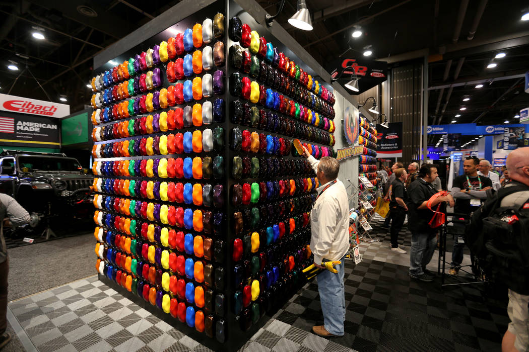 Gary Grubb of Fairfield, Ohio, looks for a color for his car at the House of Kolor booth at the Specialty Equipment Market Show at the Las Vegas Convention Center Wednesday, Oct. 31, 2018. The SEM ...